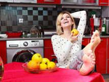 Woman sit in the kitchen with fruit Royalty Free Stock Photography