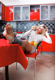 Woman sit in the kitchen with fruit Stock Images