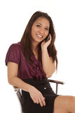 Woman sit phone smile look Royalty Free Stock Photo