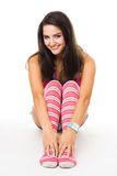 Woman sit in pink striped socks smiling look at ca Royalty Free Stock Photography
