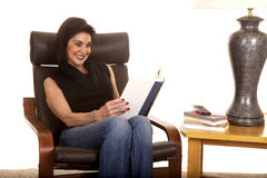 Woman sit and read by lamp Stock Photo
