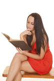 Woman sit red dress book reading Stock Image