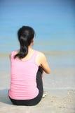 Woman sit seaside Stock Photography