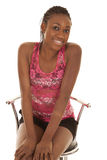 Woman sit shrug pink tank Royalty Free Stock Images
