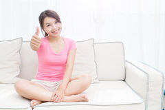 Woman sit on sofa Stock Photography