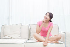 Woman sit on sofa Royalty Free Stock Photos