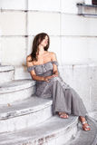 woman sit on stairs outdoor Stock Photos