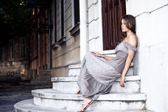 woman sit on stairs outdoor Royalty Free Stock Photography