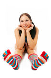 Woman sit in strip sock. On white background Stock Photo