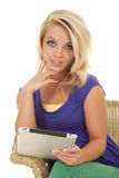 Woman sit with tablet green pants looking stock photos