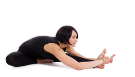 Woman sit in yoga asana - Janu Sirsasana isolated Stock Image