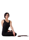 Woman sit in yoga pose with beads - padmasana Royalty Free Stock Photos