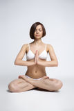 Woman sit in yoga pose - lotos Stock Photos