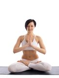 Woman sit in yoga pose - lotos on rubber mat Stock Image