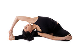 Woman sit in yoga pose - Parivrtta Janu Sirsasana Royalty Free Stock Photo