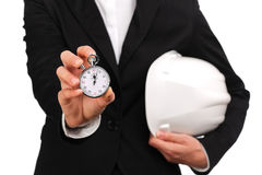 Woman site manager holding a stopwatch Royalty Free Stock Image