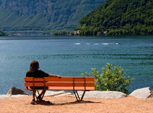 Woman siting in the bench Stock Photo