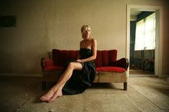 Woman Siting on Sofa Seat stock images