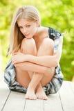 Woman sits Stock Photos