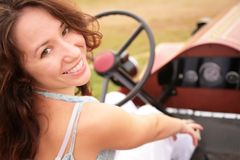 Woman sits in ancient car Stock Photography