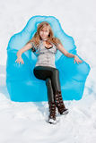 Woman sits in an arm-chair outside in winter Royalty Free Stock Photography