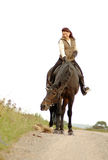 Woman sits astride a horse on white background. Woman sits astride a horse Stock Photo