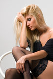 Woman sits and cries Stock Photo