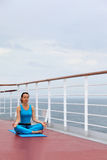 Woman sits on cruise liner deck Stock Photos