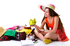 Woman sits near filled suitcase. Stock Photography