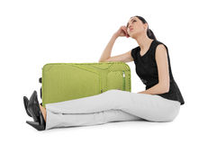 Woman sits near suitcase. Stock Photography