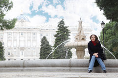 Woman sits next to fountain in gardens of Sabatini Royalty Free Stock Image