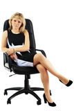 The woman sits on office armchair Stock Photos