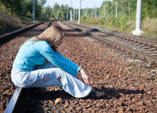 The woman sits on rails Stock Photography