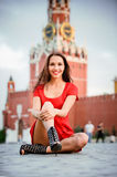 Woman sits on Red Square Royalty Free Stock Photo