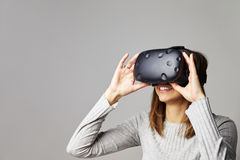 Woman Sits On Sofa At Home Wearing Virtual Reality Headset Stock Photography