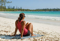 Woman Sits On Tropical Beach Stock Images