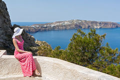 Woman sits and watches the sea. Greece Santorini Stock Photo