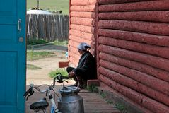 Woman sitted in front of her house, Ihtamir, Mongolia. Royalty Free Stock Image