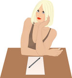 Woman sitting. At desk with piece of paper and pen Royalty Free Stock Image