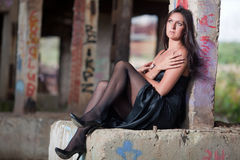 Woman sitting in an abandoned factory Stock Photography