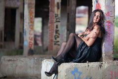 Woman sitting in an abandoned factory Royalty Free Stock Photo