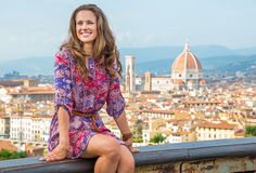 Woman sitting against panoramic view of florence Royalty Free Stock Image