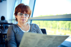 Woman sitting in the airport cafe and waiting for departure. Stock Image
