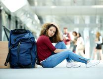 Woman sitting at airport Stock Photography