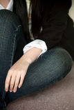 Woman sitting alone. In jeans and a jacket Stock Photography