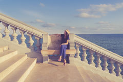 Woman sitting alone on a bench Royalty Free Stock Images