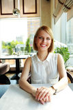 Woman sitting alone in cafe Royalty Free Stock Photography