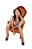 Woman sitting on armchair. Stock Images