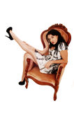Woman sitting on armchair. Stock Photos