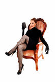 Woman sitting in armchair. royalty free stock image